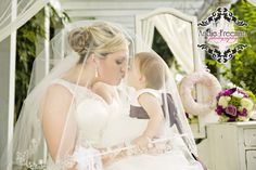Bride and flower girl portrait in front of vintage white vanity under white majesty canopy.  Classic Fall Wedding.  Photography:  Andie Freeman Photography www.TheAthensNewbornPhotographer.com  Coordinating:  Wild Flower Event Services Venue:  The Thompson  House and Gardens, Bogart, GA Floral:  Flowers by On