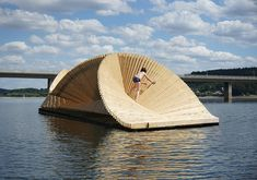daewha kang design creates circe, a floating pavilion made of 278 identical pieces of wood