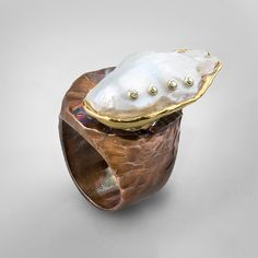 An exclusive German Kabirski ring that was bought in a London Boutique. Pearl & Sapphires.