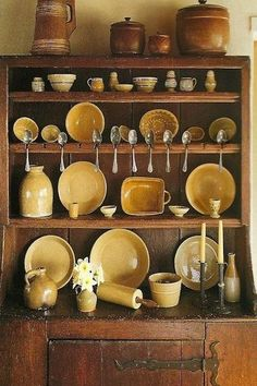 Country Cupboard / Full of, a wonderful collection of, mellow yellow. Primitive Kitchen, Primitive Antiques, Primitive Decor, Country Cupboard, Antique Cupboard, Kitchen Cupboard, Antique Stoneware, Antique Pottery, Pie Safe