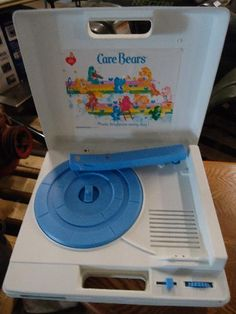 My love of music began with this 80s Christmas Gift, a Care Bear record player- this exact one.  I checked out albums from the library like nobody's business.