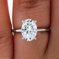 Oval Cut Solitaire Engagement Wedding Ring 1 Carat Solid 14k Real White Gold. Kinda like the Oval.  Too bad the model's hand is fat and tan.