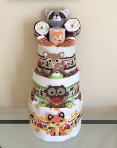 Woodland Critters Baby Boy Diaper Cake  Probably my favorite diaper cake. I have a swaddle that could be used and the top would be a monkey lovie