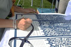 Damara Does Design wedding certificates - Guest signing Lotus design at a Long Island outdoor beach wedding