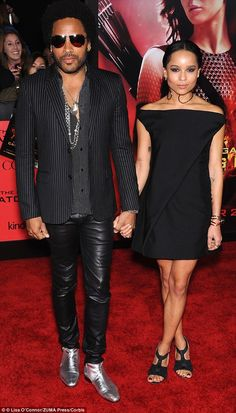 American Woman: The rocker pictured with his daughter Zoe at the Hunger Games: Catching Fire premiere, in which Kravitz plays stylist Cinna