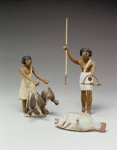 A depictiction from Egypt, Upper Egypt, Thebes, Southern Asasif, Tomb of Meketre (TT 280). Two wooden models, a man and a woman in a hunting scene. The woman holds ducks, the man is hunting on fish. Dynasty 12 ca. 1981–1975 BC. MET New York