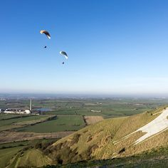 Paragliders at the Westbury White Horse, Wiltshire, UK