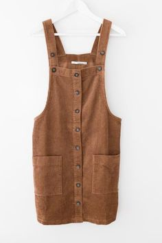 Soft corduroy dress overalls Button down front Large front pockets Strap length is adjustable Loose fitting 100% Cotton Imported