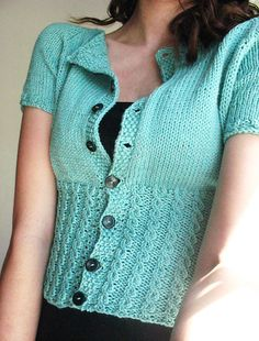 Free Knitting Pattern Peggy Sue Cardigan - Linda Wilgus was inspired by styles to design this short-sleeved cropped cardigan featuring cables at the waist. SIZE: XS [S, M, L, Pictured project by Elidee. Knitting Designs, Knitting Patterns Free, Knit Patterns, Free Knitting, Knit Shrug, Knit Vest, Cardigan Pattern, Cropped Cardigan, Lana