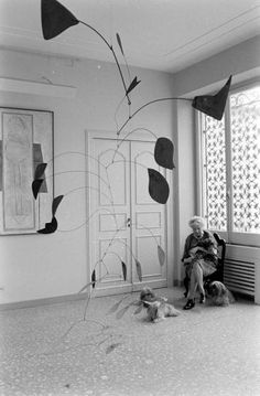 Peggy Guggenheim with Alexander Calder sculpture.