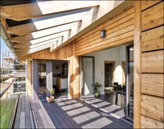 A striking new house in County Cork proves that meeting the passive house standard needn't mean sacrificing good design A striking new house in. Ireland Homes, House Ireland, Dutch House, Passive House, Living Spaces, Porch, Pergola, Outdoor Structures, Flooring
