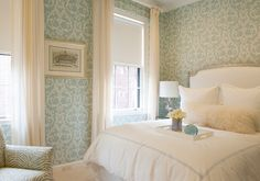 Print wall paper and white curtains.