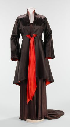 """Evening Ensemble, Elizabeth Hawes (American, 1903–1971): spring/summer 1934, American, silk. """"This dress is a luxurious example of """"at-home"""" wear. Hawes found much inspiration from the work of Madeleine Vionnet, which is exemplary in the cut of the entire garment and the interesting drapery effect at the back. The use of a bold accent and interior lining color in contrast with the dark exterior fabric is a signature of the designers'."""""""