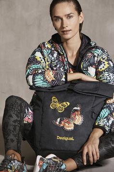 Desigual leggings block metamorphosis with a reflective logo.  Desigual lightweight sports jacket with a very colorful print and zipper fastening and Desigual black backpack with embroidered details. Discover new Desigual Sport collection!