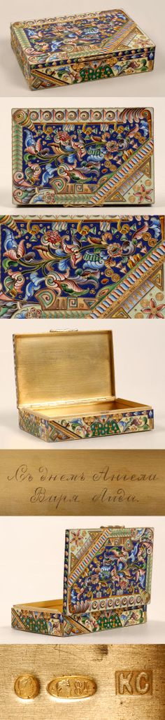 A Russian silver gilt and shaded cloisonne enamel table cigarette box, Konstantin Skortsov, Moscow, circa 1908-1917. Of rectangular shape, the sides and hinged top completely enameled in stylized multi-color scrolling floral motifs within bands of various geometric borders.