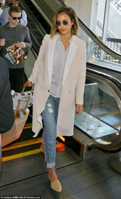 Back to the boardroom: Jessica Alba channelled her business side when she strolled through LAX in a chic white cream coat on Tuesday