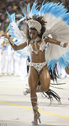Samba: Dressed in minimal costumes, dancers take part in a parade in Sao Paulo