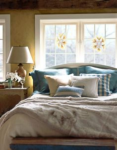 Van Breems painted her Gustavian-style headboard white, in the Swedish custom of using pale colors to combat winter darkness.