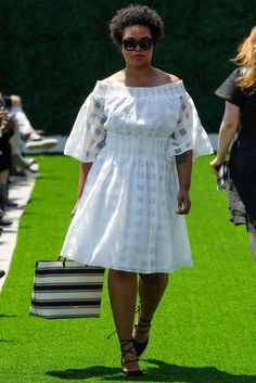 A white gingham, of-the-shoulder dress at the Christian Siriano for Lane Bryant fashion show is the perfect spring and summer outfit staple you need in your wardrobe.