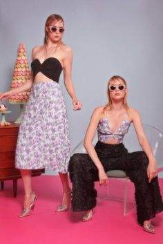 Luxe Style | Christian Siriano Resort 2017 | Black twist tube top with purple floral midi skirt and purple floral twist tube top with black floral trousers | The Luxe Lookbook