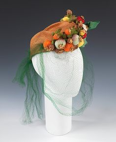 Hat  Sally Victor  (American, 1905–1977)    Date:      1933  Culture:      American  Medium:      straw, synthetic, silk, raffia  Dimensions:      9 1/2 x 18 1/2 in. (24.1 x 47 cm)  Credit Line:      Brooklyn Museum Costume Collection at The Metropolitan Museum of Art, Gift of the Brooklyn Museum, 2009; Gift of Sally Victor, Inc., 1944