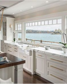 Stylish lakefront home with all white kitchen, marble countertops, and brass har. - Stylish lakefront home with all white kitchen, marble countertops, and brass hardware accents - All White Kitchen, New Kitchen, Kitchen Decor, Kitchen Ideas, Kitchen Modern, Rustic Kitchen, Modern Kitchens, Kitchen Upstairs, Classic White Kitchen