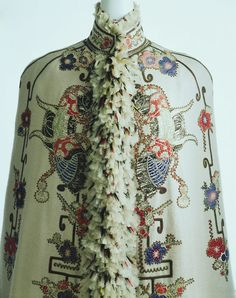 Visite Made Of Off-White Cashmere Twill, Appliques Of Embroidered Fabrics With Kabuto (Samurai Helmet), Butterfly And Cherry Blossom Motifs, Feathers At Front Collar And Back Slit   c.1890   - The Kyoto Costume Institute