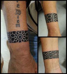 dark-ink-mandala-tattoo-on-wrist.jpg