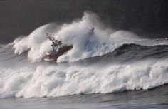 A Canadian Coast Guard boat in big waves off of Tofino, British Columbia