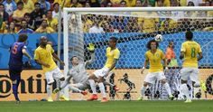 Daley Blind of the Netherlands shoots to score against Brazil. REUTERS/Ueslei Marcelino