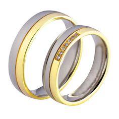 Obrączki ślubne z białego i żółtego złota z brylantami o łącznej masie 0,07 ct. Próba 0,585
