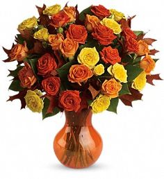 Autumn is a many-splendored thing, and this glorious bouquet is proof. The season's most amazing flowers in a chic serendipity vase - what a spectacular splash of color and style! Bask in it.  Yellow, orange and light-orange spray roses - accented with preserved oak leaves and lemon leaf - are delivered in a sparkling orange Serendipity vase.