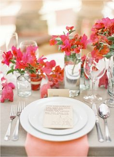 Lush coral palette - beautiful bougainvillea arrangements complements it so well too.