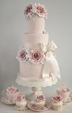 Frilly and fancy vintage wedding cake with roses and ribbons