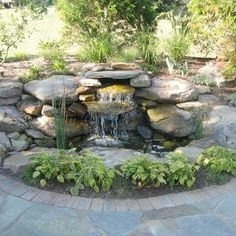 A splashing waterfall serves as the perfect patio backdrop for these TOH readers' outdoor oasis. | thisoldhouse.com