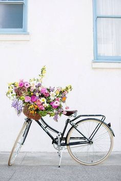 Spring Flower Arrangements flowers in a bike basket
