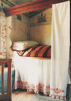 The guess is this is a Swedish room based on the embroidery mostly I think. Oh, looking at those walls again makes I'm sold. They may be Gustavian. Funny, we think Swedish design means Ikea brand. Check Gustavian design if you like odd or baroque forms.