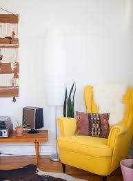 Bright yellow chair as the focal point in a natural-toned living room. // A Sunny Home for Two Free-Spirited Midwesterners Ikea Living Room, Living Room Chairs, Dining Chairs, Strandmon Ikea, Yellow Armchair, Yellow Chairs, Ikea Yellow Chair, My New Room, Home And Living