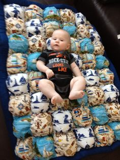 Biscuit Quilt for baby.... I simply LOOOOVE the nautical theme. This is what Chase has for his room theme.