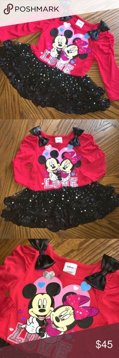 "NWOT•""Disney""Minnie&Mickey Sequined, Ruffled Dress 🆕 NWOT•""Disney"" Minnie Mouse & Mickey Mouse Sequined, Ruffled, Sparkly Dress • Red Top • Black Layers of Skirt & Ruffles • Satin bows on each shoulder • Features Minnie & Mickey on the front hugging each other • Glitter, Sparkly hearts here & there • Tulle bow on Minnie's head • The word ""LOVE"" on the bottom in Sparkles! SO PRETTY!! 🎀 BRAND NEW WITHOUT TAGS!! 🎀 ➡️ If you have any further questions, please ASK. Disney Dresses Formal"