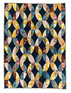 Love This : Metro Twist Quilt sewing pattern from Sew Kind of Wonderful