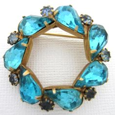 """Aqua Sapphire Blue Pear Shape Rhinestone GT Wreath Pin Brooch. 1 1/2"""" wreath pin / brooch in very good condition! Prong set rhinestones- some of the smaller stones on the outside have darkened. Only adds to th"""