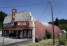 At the Rio Theater, $7 gets you admission to a first-run movie, a chance to see friends and neighbors, and a blanket.  [...] it's the customers' turn to give some warmth back to the Monte Rio theater, a 240-seat Quonset hut - one of those World War II-era prefabricated cylindrical steel buildings - that is as much a part of the Russian River as the towering redwoods, Bohemian Grove and lazy afternoons in a kayak.  Faced with a $60,000 bill for digital projection equipment mandated by ...