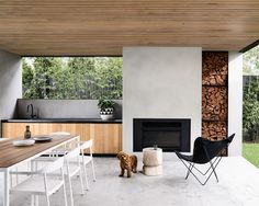 Outdoor kitchens: Round up of the best! Timber and concrete outdoor kitchen, sle… Outdoor kitchens: Round up of the best! Timber and concrete outdoor kitchen, sleek outdoor kitchen, modern outdoor kitchen House, Home, House With Porch, Outdoor Kitchen Design, Outdoor Rooms, Modern Outdoor Kitchen, Porch Design, Modern, Outdoor Fireplace