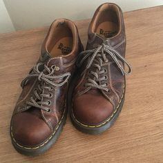 Dr Martens leather shoes( unisex) These are in really great shape with a lot of life in them. Please see picture where there is a small scuff towards the back. There is a black mark on the heel inside the shoe. These are worn.  These are unisex and these are size 9 men. Dr. Martens Shoes Combat & Moto Boots