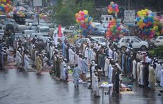 Pakistani Muslims offer Eid al-Fitr prayers on a street during the first day of their religious festival in Karachi on August 9, 2013. Muslims around the world are celebrating the Eid al-Fitr holiday, which marks the end of the fasting month of Ramadan.