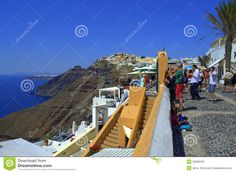Picture taken in Santorini,Greece on September 7th,2013 -unique,amazing island.This is  the main pedestrian street in the capital Fira.Every year, thousands of tourists from all over the world visit Santorini to discover the famous submerged caldera, the volcano's crater, which is situated today in the middle of a 32 square miles basin of water. Around the basin, hanging on cliffs of 150m to 300m height, one can admire some of the most beautiful traditional villages of the Cyclades. The…