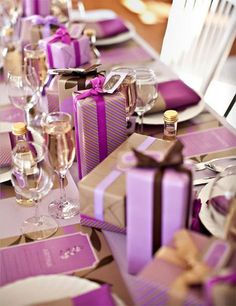 So pretty! Thanks for posting, Faith! Lovely lilac wrapped gift boxes as centerpieces #giftwrap