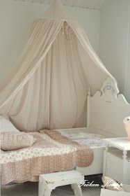 Canopy Bed - create a canopy by hanging a fabric- and string light-wrapped hula hoop from the ceiling, then drape the fabric around the bed - via Froken Knopp