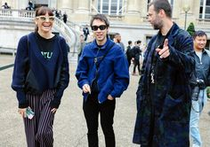 Shauna Toohey in a Sacai sweater and P.A.M. T-shirt, Jun Takahashi, and Misha Hollenbach in a Sacai coat